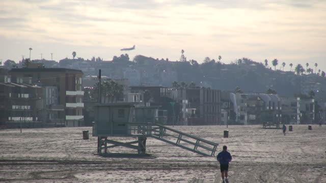 (HD1080i) Aircraft Lands behind Beach Runner video