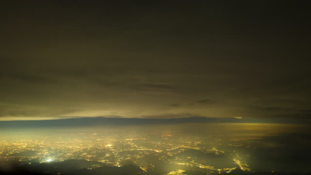 aircraft pov time lapse overflying milano and mediterranean sea by night - lombardia video stock e b–roll