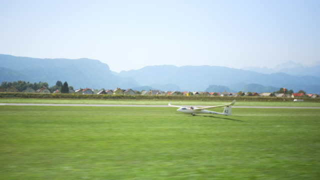 TS Aircraft towing the glider off the runway and into the air in sunshine