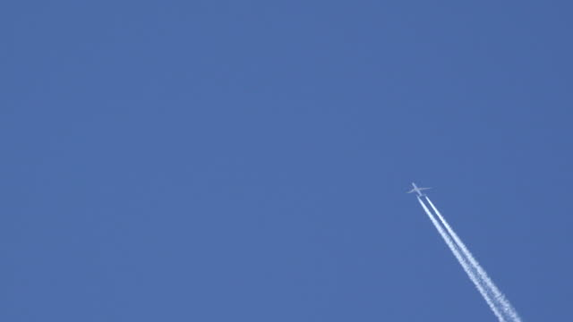 Aircraft traces on the blue sky