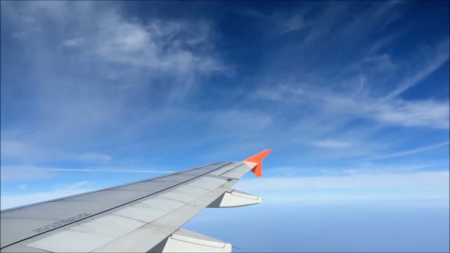 Aircraft wing flying through the clouds. video