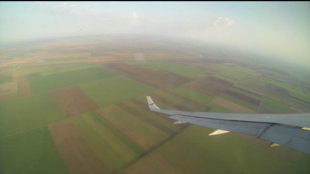 Aircraft wing over the fields video