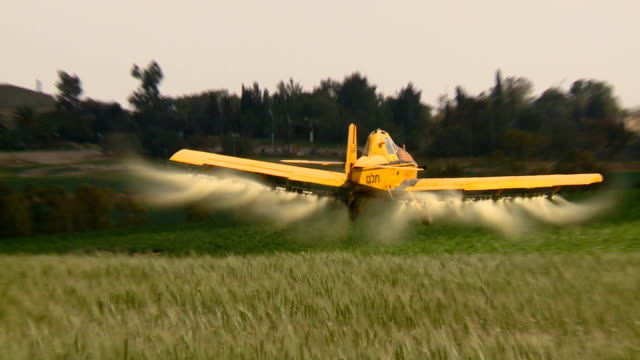 Aircraft. Yellow agriculture aircraft , crop duster with sound. video