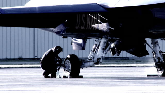 Aircrew Cleaning 24_1 Aircrew cleaning the wheels on an F-18 Hornet fighter plane. us military stock videos & royalty-free footage
