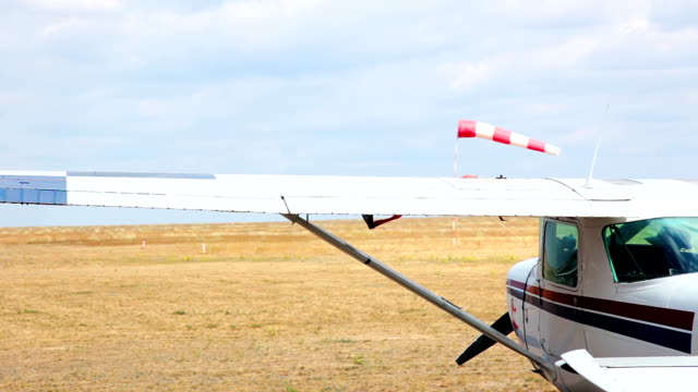 Airfield in the steppe Steppe. Overcast. The shadow of a cloud moving. A small plane. Small helicopter flying in the background. airfield stock videos & royalty-free footage