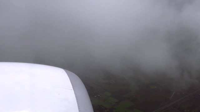 Airliner is flying in a bad weather conditions video