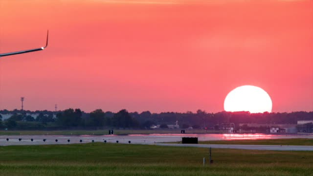 Airliner Landing at Vibrant Sunset in Houston Texas video