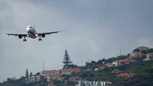 Airliner Lands at Madeira Funchal Airport. Airbus A 321 UltraHD 4K 2160p Video Airliner Lands at Madeira Funchal Airport. Airbus A 321 UltraHD 4K 2160p Video. Commercial Passenger Airliner Airbus A321 by Air Berlin at Cristiano Ronaldo Madeira Funchal Airport 4k D-ABCH funchal stock videos & royalty-free footage