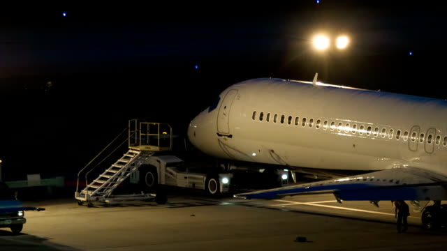 Airliner Parked in Evening on Overnight Lot Platform video
