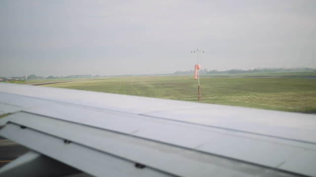 Airplane about to take off.  Daytime shot from inside of plane. video