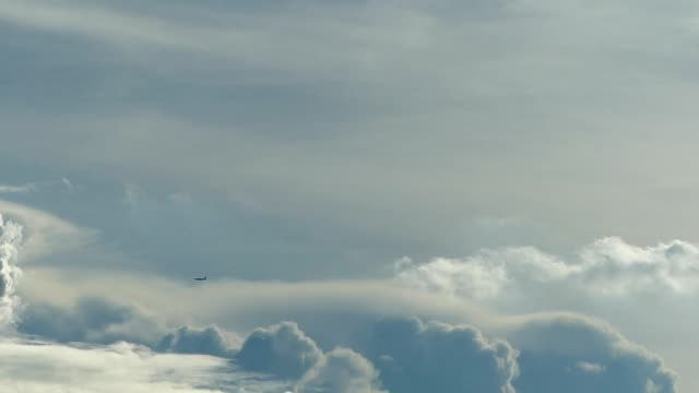 Airplane and moving clouds video