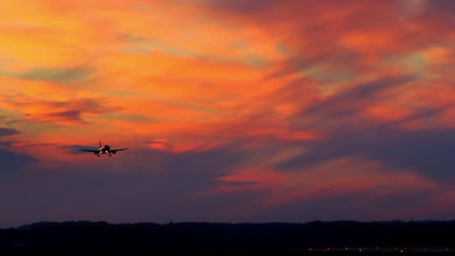 Airplane Approaching Airport Runway on Spectacular Sunset Clouds Background Airplane Approaching Airport Runway on Spectacular Sunset Clouds Background airfield stock videos & royalty-free footage