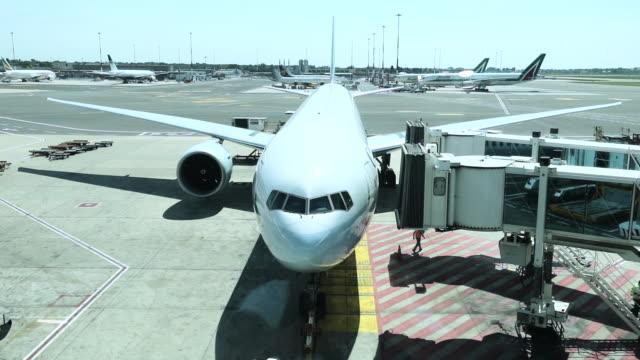 Airplane boarding before departure Airplane boarding before departure airfield stock videos & royalty-free footage