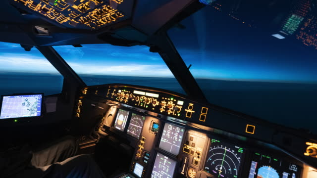 airplane cockpit view of noctilucent clouds time lapse (cockpit pov) - pilota video stock e b–roll