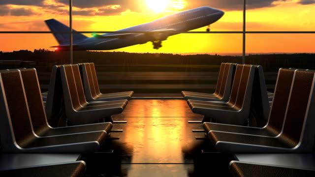 airplane departure against scenic sunset seen through departure lounge windows - аэровокзал стоковые видео и кадры b-roll
