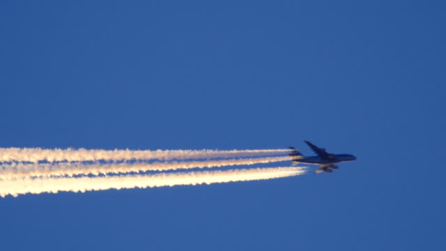 Airplane fly by contrail closeup