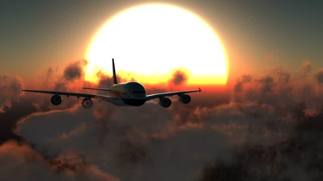 Avión volando al atardecer - vídeo