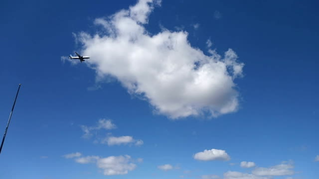 Airplane Flying Between Clouds Video Airplane Flying Between Clouds Video florida us state stock videos & royalty-free footage
