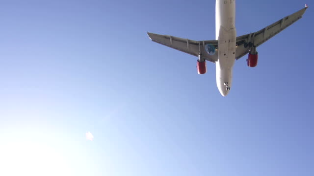 Airplane flying over the camera while descending video