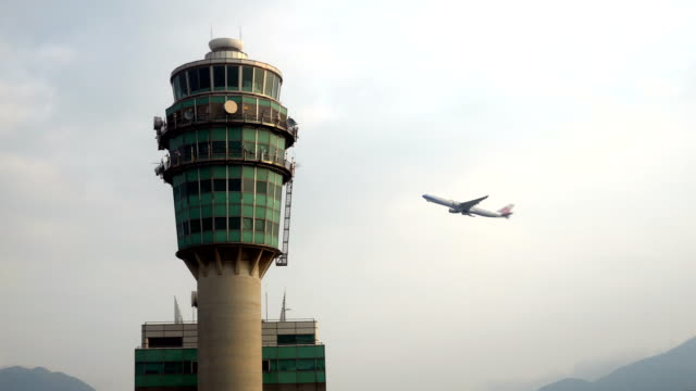 Airplane flying pass Air Traffic Control Tower video