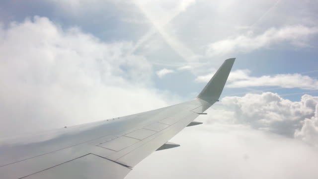 Airplane flying through clouds video