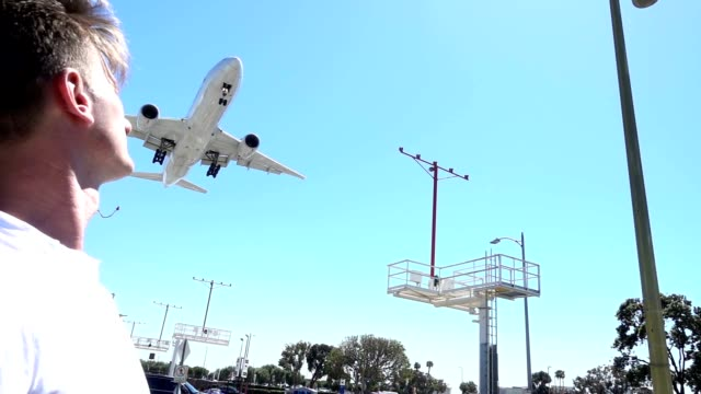 SLO MO Airplane flyover a mid adult man video