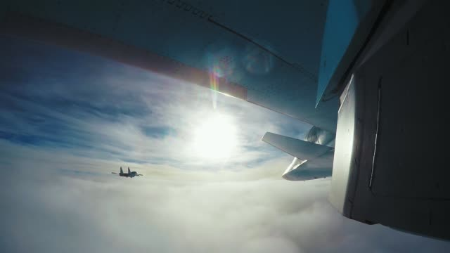 Airplane, Gopro, SU-34 Plane above the clouds. Gopro shot under the wing, SU-34 cockpit stock videos & royalty-free footage