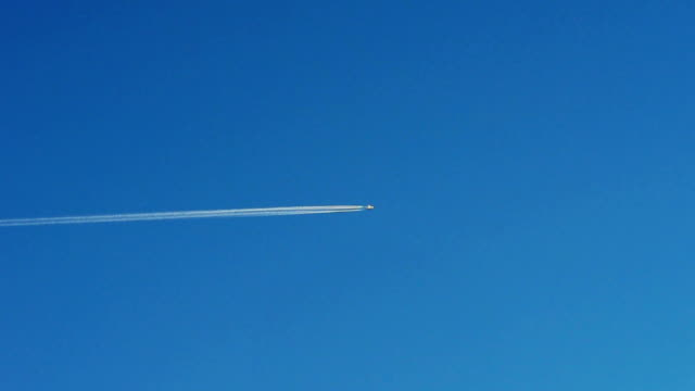 HD Airplane jet layer, aircraft pollution over the blue sky,transportation concept video