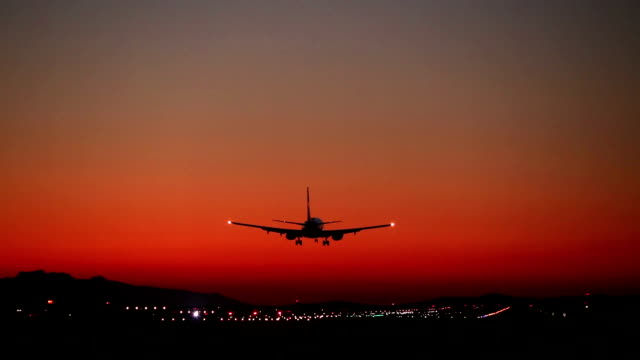 Airplane Landing Airport Vancouver Airplane landing on airport runway during sunset in Vancouver, British Columbia, Canada. (YVR) vancouver canada stock videos & royalty-free footage