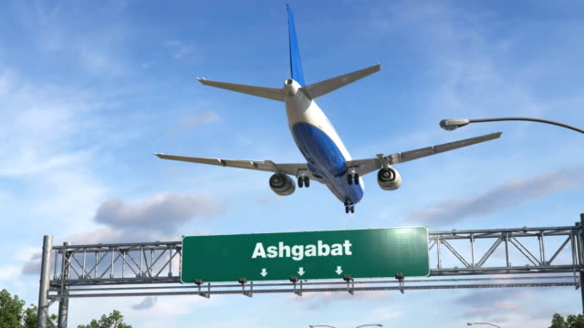 Airplane Landing Ashgabat Airplane flying over airport signboard turkmenistan stock videos & royalty-free footage