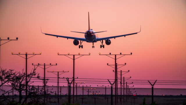 Airplane Landing At LAX Airport At Dusk video