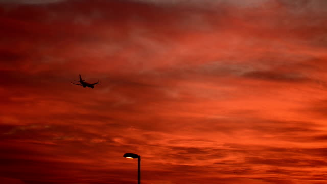 Airplane landing during the sunset video