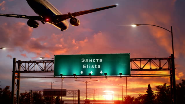 airplane landing elista during a wonderful sunrise - lingua russa video stock e b–roll