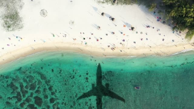 Airplane landing in a tropical island - Holidays start