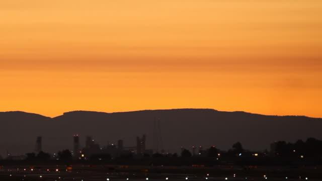 HD airplane landing in sunset video