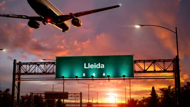Airplane Landing Lleida during a wonderful sunrise Airplane flying over airport signboard lleida stock videos & royalty-free footage
