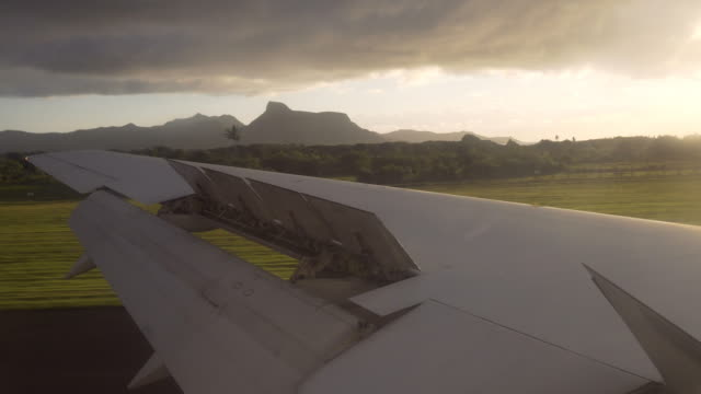 Airplane landing on a tropical island at sunrise video