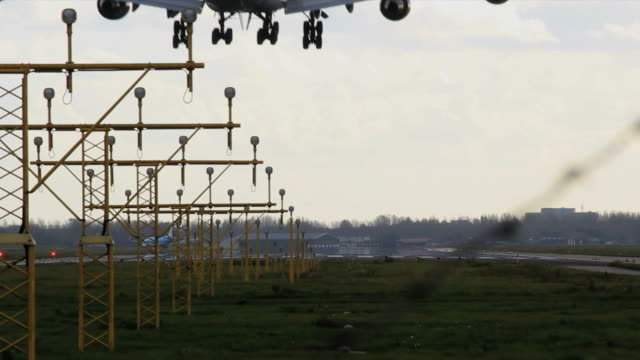 stockvideo's en b-roll-footage met airplane landing on schiphol airport - schiphol