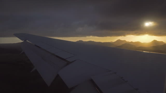 Airplane landing on tropical island at sunrise video