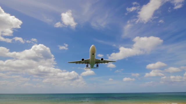 Airplane landing over the sea video