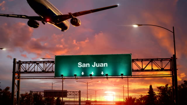 Airplane Landing San Juan during a wonderful sunrise Airplane flying over airport signboard puerto rico stock videos & royalty-free footage