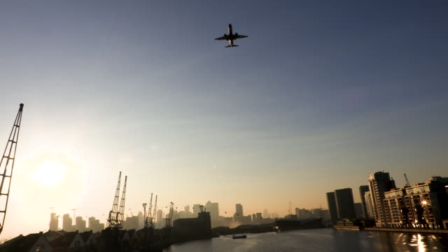 Airplane lands at sunset of London