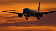 istock Airplane on final approach at sunset 1278751655
