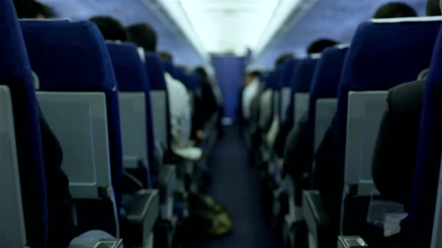 Airplane Passengers during a flight Passengers in a commercial airplane during a flight plane stock videos & royalty-free footage