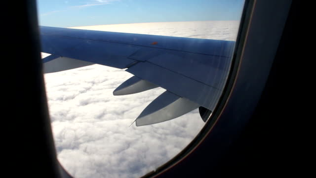 Airplane Seat - View of Wing of Plane on Flight Airplane Window Seat - View of Wing of Plane on Flight, Traveling in Air over City and clouds seat stock videos & royalty-free footage