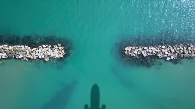 Airplane shadow on the sea video
