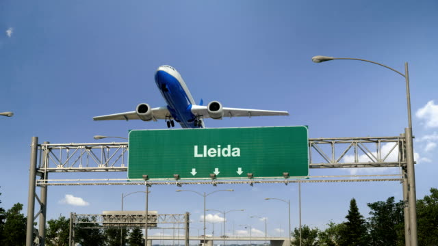 Airplane Take off Lleida Airplane flying over airport signboard lleida stock videos & royalty-free footage