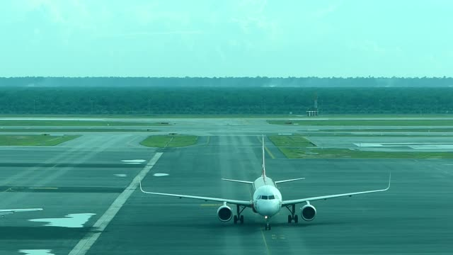 Airplane taxiing at the airport