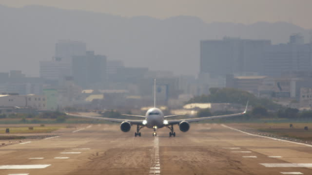 Airplane to take off from the runway - Fix Video of the airplane taking off from the airport taken from the front. Camera work is fixed. plane stock videos & royalty-free footage