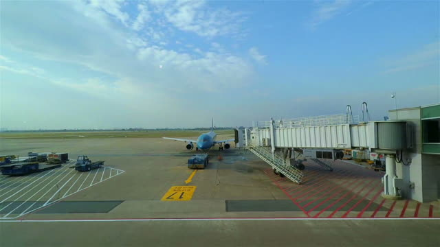 Airplanes parked at large airport video